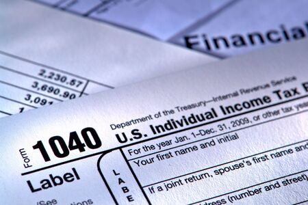 American IRS Internal Revenue Service income tax form 1040 and financial papers photo