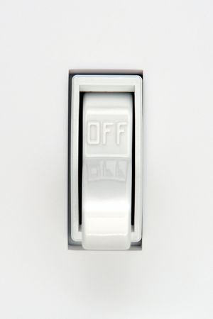 toggle: Traditional North American toggle electric light switch in OFF position