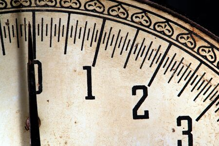 Old worn antique scale dial with roman numeral numbers photo
