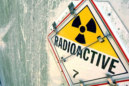 Radioactive danger warning placard sign on grunge metal surface  Stock Photo - 7099478