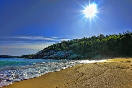 maine: The coast of Maine at Sand Beach in Acadia National Park at Sunset