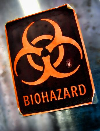 hazardous waste: Biohazard universal symbol danger warning label on a hazardous waste container in a science research lab