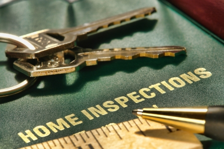 House real estate home inspection folder with keys ruler and pen