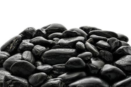 smooth: Pile of small smooth polished black river stones and pebbles over white background