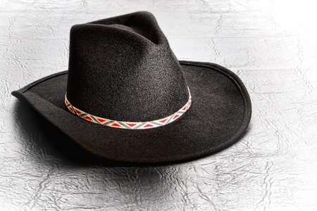 stetson: American West Stetson style traditional western black felt cowboy hat on leather surface