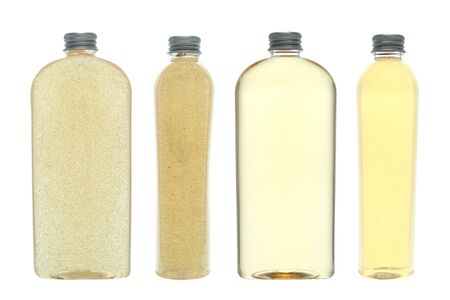 cleanse: Generic cosmetics bottles of liquid scented body shower wash oil and skin cleansing scrub in front and side views isolated over white  Stock Photo