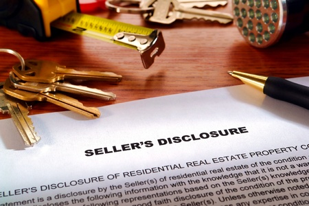 Real estate homeowner seller property disclosure condition statement with house keys and inspection flashlight on a home owner desk (fictitious but authentic language document)