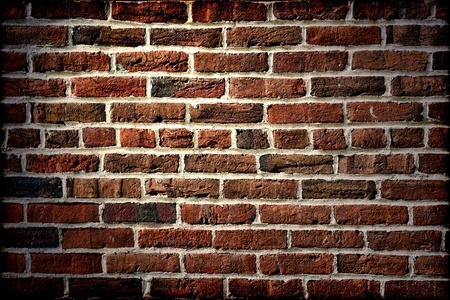 historic place: Old antique brick wall with one short end row in the middle in vintage lighting on a historic place Stock Photo
