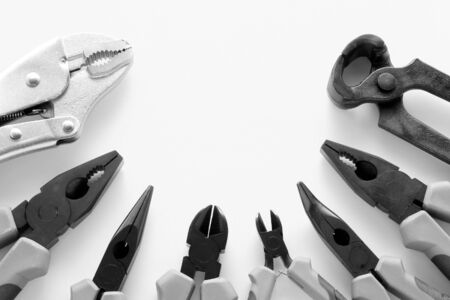 Assorted pliers tools collection including cutter, breaker, grozier, needle-nose, pincer, and locking in high contrast black and white photo