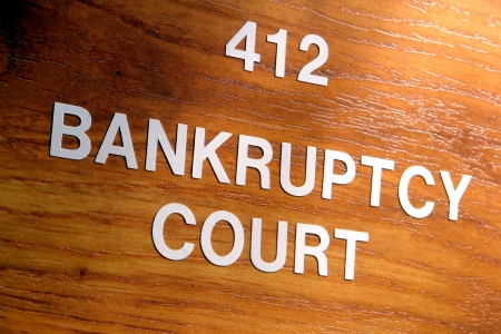 Bankruptcy court sign outside a Title 11 insolvency case resolution and judgment chamber in a courthouse