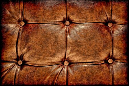 Grunge antique buttoned leather background with old worn brown texture and natural aged wear Banco de Imagens