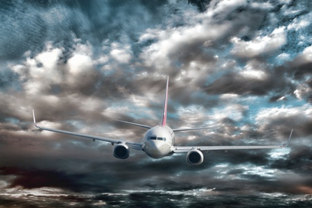 Passenger airline plane in imminent crash danger viewed from an aircraft above flying close to the violent water of ocean waves while trying to avoid a disaster in a fierce storm with dramatic stormy sky Stock Photo - 10263190