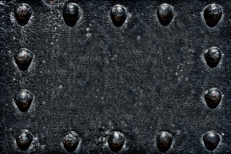 corroded: Grunge industrial black steel background of rough and rusty corroded metal surface with rivets Stock Photo