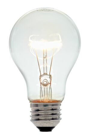 Bright clear glass lit incandescent electric light bulb with glowing filament isolated on white