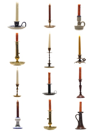 Collection of old antique ceramic or brass and metal candlestick candleholder with vintage candle isolated on white