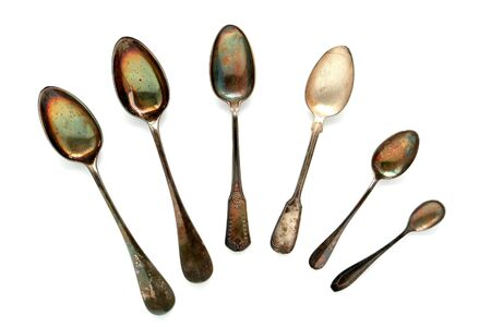 tarnished: Antique old and tarnished historic soup and dessert silver spoon collection on white