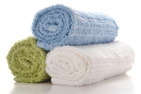 white towels: Soft and fluffy rolled up cotton towels on white Stock Photo