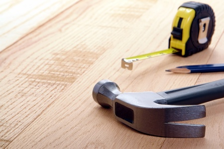 doityourself: Carpenter tools on oak wood boards with with claw hammer and retractable  tape measure Stock Photo