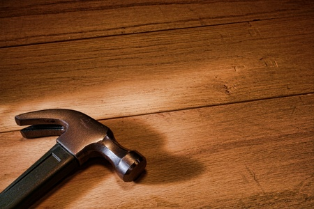 Carpenter claw hammer tool on oak wood boards in a construction workshop Stock Photo - 10287046