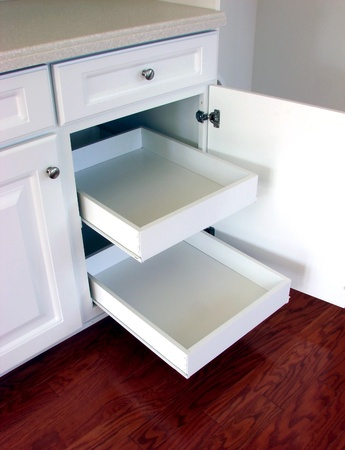 drawers: Pull out kitchen shelf drawers in modern laminated cabinets in a modern house Stock Photo