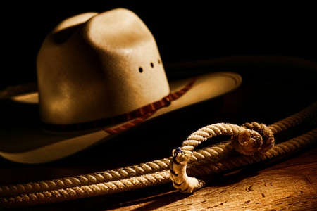 ranching: American West rodeo cowboy lasso rope with white straw hat