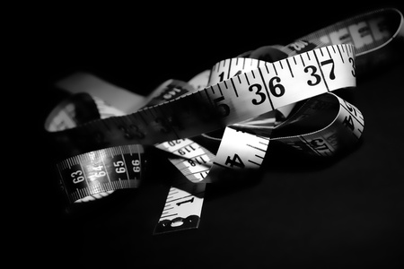 number 36: Ribbon tape measure with emphasis on the number 36 as the ideal American man waist line