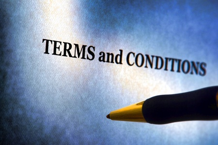 condition: Terms and conditions legal disclosure information notice on a sheet of paper with ballpoint pen ready to sign Stock Photo