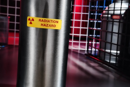 Radiation hazard danger warning sign on a steel pipe in a nuclear science research lab Stock Photo - 10302839