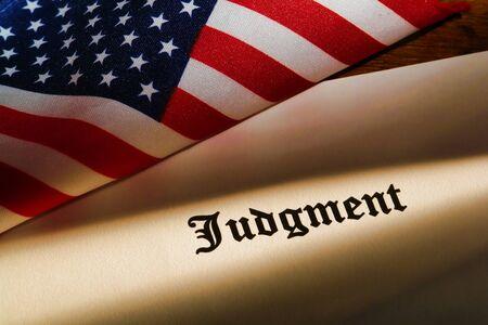 Judicial judgment decree with small American flag on a court judge desk 版權商用圖片