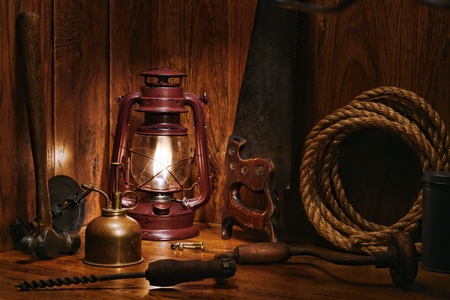kerosene lamp: Antique craftsman carpenter wood workshop with kerosene lamp burning and old hand tools