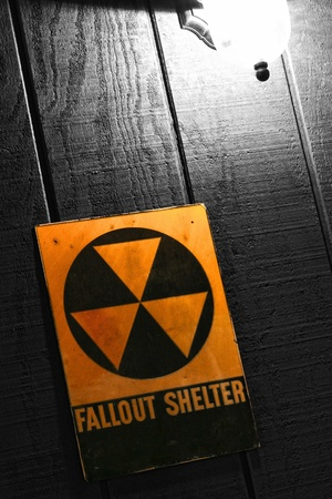Vintage Cold War era civil defense emergency fallout nuclear bomb shelter sign photo