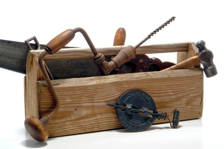 box construction: Antique work tools in an old vintage wood toolbox over white Stock Photo
