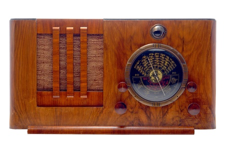 Antique 1930's Art Deco style tube radio with wood cabinet and magic eye isolated on white