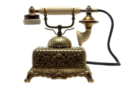 Ornate antique brass cradle type twenties telephone isolated over white