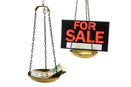 Stack of cash and for sale sign on a balance scale as metaphor for corrupt justice isolated on white