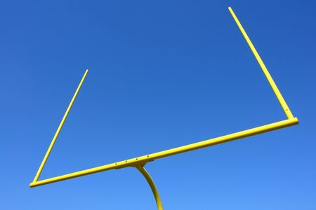 American football goal posts over perfect blue sky photo