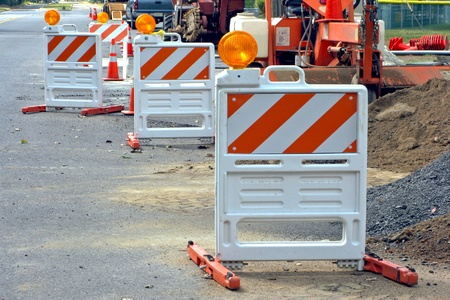 barrier: Reflective safety traffic barriers at road highway construction site Stock Photo