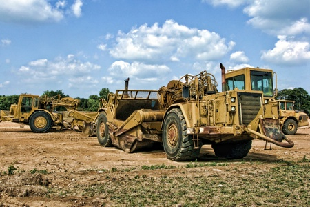 ヘビーデューティ地球移動装置建設敷地とホイール トラクターのスクレーパー 写真素材