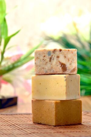 artisanal: Stack of artisanal natural aromatherapy bath, soap bars in a spa Stock Photo