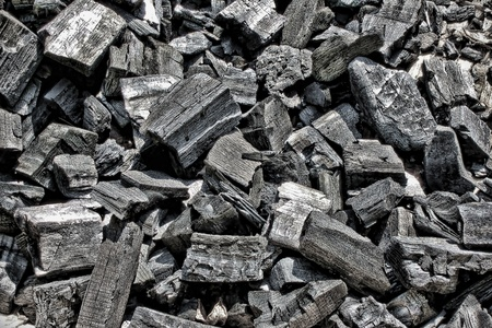 Dry wood black charcoal pieces in a pile after pyrolysis burn as a background Stock Photo - 10328703