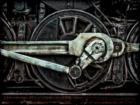 Grunge old steam locomotive wheel and rods