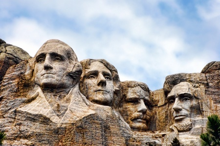 Mount Rushmore National Memorial in South Dakota featuring four famous United States historic presidents carved on  a mountainside