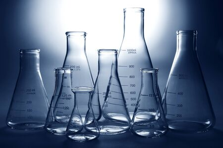 Glass Erlenmeyer flasks empty and ready for an experiment in a science research lab photo