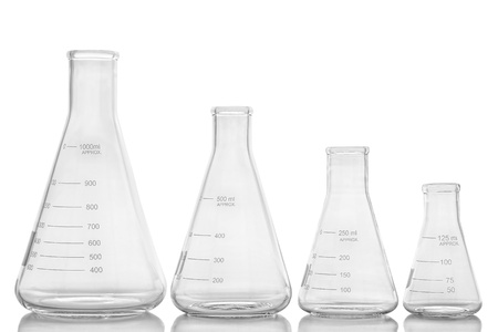 Glass Erlenmeyer flasks of assorted sizes empty and in a row for an experiment in a science research lab
