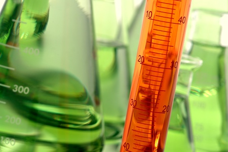 Graduated scientific cylinder and laboratory glassware ready for an experiment in a science research lab photo