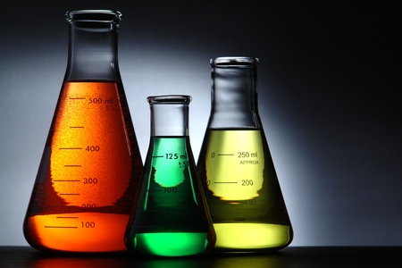 medical laboratory: Glass Erlenmeyer flasks filled with liquid for an experiment in a science research lab