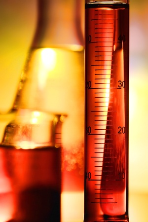 Scientific graduated cylinder filled with liquid for an experiment in a science research lab Stock Photo