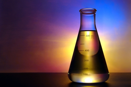 Glass Erlenmeyer flask filled with liquid for an experiment in a science research lab