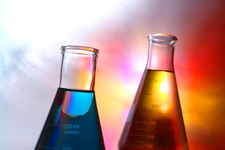 Glass Erlenmeyer flasks filled with liquid for an experiment in a science research lab