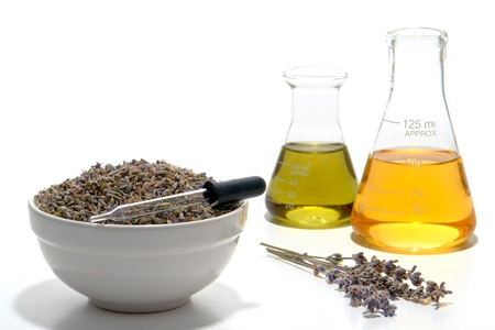 scent: Aromatherapy preparation process of lavender flower seeds with glass pipette dropper and Erlenmeyer flasks filled with scent chemical and fragrance essential oil  Stock Photo